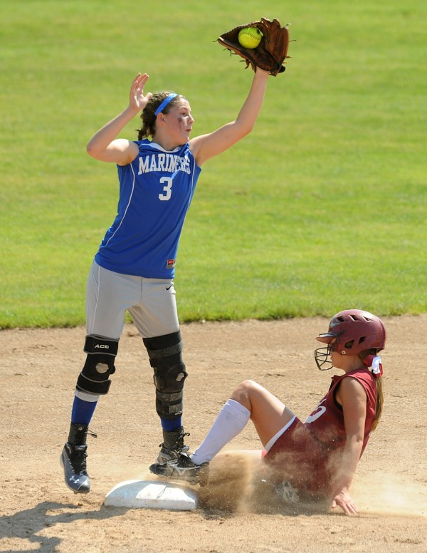 Deer Isle-Stonington High School's Janelle Ciomei catches the late throw as Richmond Regional High School's Danica Hurley slides to second base during the fourth inning of the Class D State Softball Championship game in Standish Saturday. Deer Isle-Stonington High School won the game 7-2.