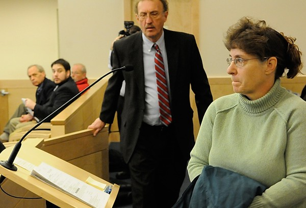 Cindy Dunton and her attorney, Dale Thistle, approach the lectern as they get ready to address Superior Court Justice S. Kirk Studstrup (not pictured) during Dunton's arraignment at Penobscot Judicial Center in Bangor in January. Dunton is accused of embezzling funds from the town of Newburgh. She is scheduled to be sentenced Friday for stealing nearly $200,000 from taxpayers since 2006.