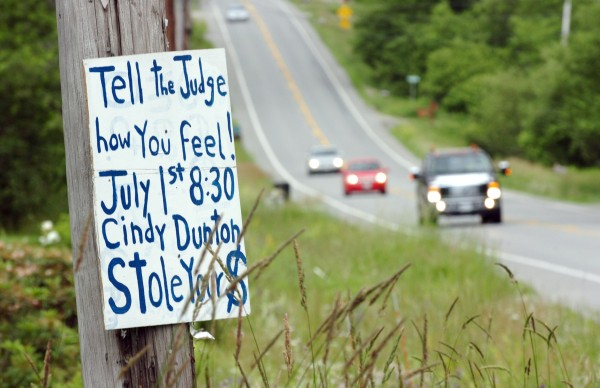 As traffic whizzes by on Route 9 in Newburgh on Thursday, June 30, 2011, homemade signs remind citizens of the Friday, July 1 court sentencing of former town deputy clerk and treasurer Cindy Dunton. Dunton pleaded guilty to Class B theft by unauthorized taking and faces a prison sentence of up to 10 years and owes the Town of Newburgh more than $250,000.