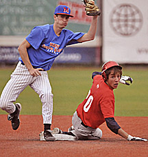East second baseman Jimmy Neal of Mt. Blue and West runner Aiden Sullivan of Yarmouth look for the call at second base during fourth-inning action of the East-West Senior All-Star game at Mahaney Diamond in Orono Friday  night. The East defeated the West 10-3.