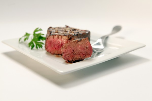Filet mignon is one of the most tender and easiest cuts of beef to cook. Get the most beefy bang for your buck by serving this cut with a sauce that adds flavor, color and texture.