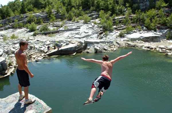 Ricky Palmer (left), 18, of Winterport watches as Nick Adams, 16, of Frankfort jumps off a ledge at the Mount Waldo Quarry in August 2010. A male who slipped while trying to take a 60-foot plunge into the quarry on Tuesday was taken to the hospital for treatment of leg injuries.