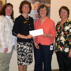 Pictured (from left)are Samantha Helander, assistant branch manager for Camden National Bank's Camden Square branch; Jane Dagley, Camden Market Manager for Camden National Bank; Ginny Vaitones, clinical care coordinator for PBMC's Cancer Care Center; and Olive Tinker, teller at Camden National Bank and a two-time breast cancer survivor.