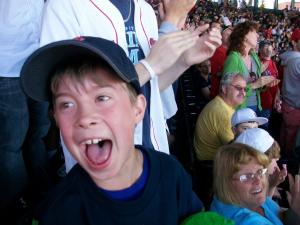 Gordon Doore, 8, of Bangor enjoys his first-ever trip to Fenway Park in Boston by celebrating a Carl Crawford home run on Sunday.