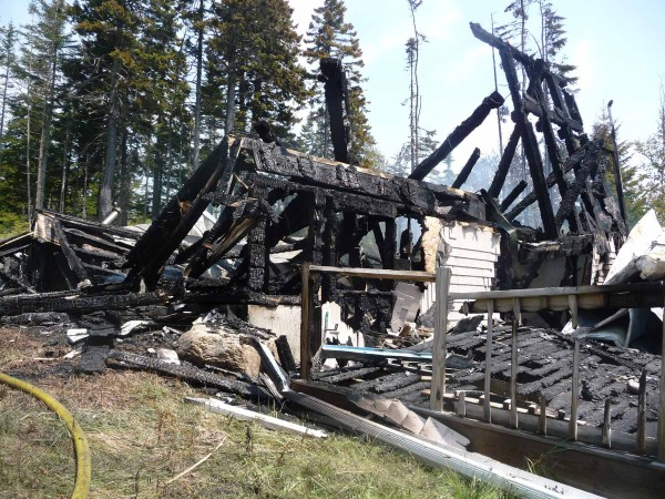 "Dr. Joan Pelligrini of Holden said a lightning strike was responsible for an early morning fire that destroyed her seasonal home on Great Wass Island. Pelligrini said lightning struck a tree and dug a trench through the soil as it traveled to the home. ""It's a total loss,"" she said, including many pieces of stained glass that she had created. ""The only thing that survived was the captain's bell on the deck."" Pelligrini was insured and said she will rebuild the home, which was built in 2006 overlooking the sea at Carver Industry Road."