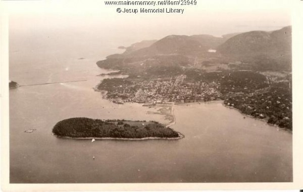 An aerial view shows Bar Harbor, circa 1920. Bar Harbor first was named the Town of Eden in 1796, then renamed Bar Harbor in 1918. Bar Island is in the foreground, and the mountains of Acadia National Park are in the background. George B. Dorr, Charles W. Eliot and later John D. Rockefeller Jr. all worked to create Lafayette National Park in 1919, which was renamed Acadia National Park in 1929.