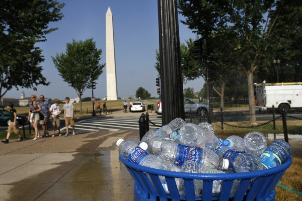 A recycling bin is full of discarded water bottles on the National Mall in Washington on Wednesday, June 8, 2011. The mercury climbed into the 90s across half the country Wednesday in a record-breaking blast of August-like heat, forcing schools with no air conditioning to let kids go home early and cities to open cooling centers. And scientists say we had better get used to it.