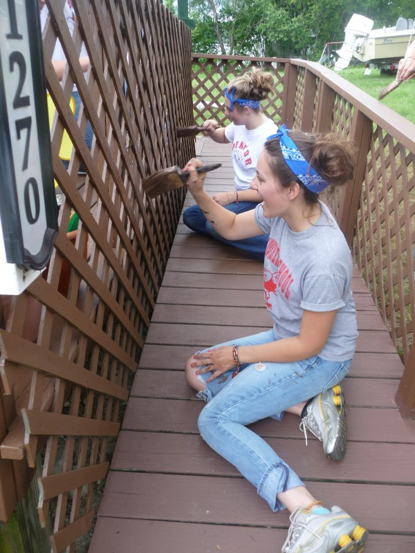"Aidan Walsh (top) and Amy Cilensek, both 17 and from Ohio, help paint the new wheelchair ramp at Iris Kent's home in Harrington. ""These kids want to help others rather than do mischief,"" Kent said Thursday. ""I'm so proud of them."""