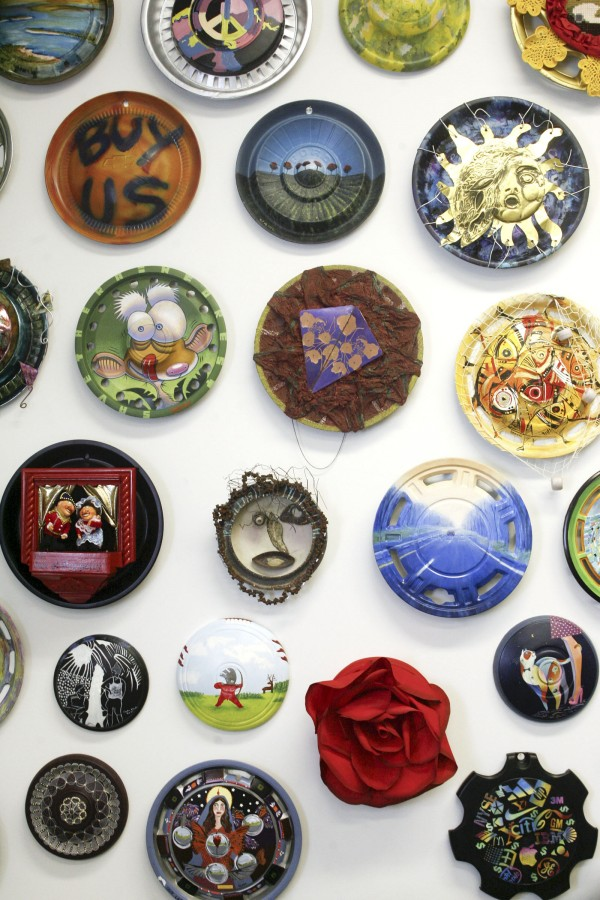 Several of the art pieces created from hubcaps that are part of the Landfillart Project are displayed in the art gallery of founder Ken Marquis in Wilkes-Barre, Pa., on May 24, 2011.