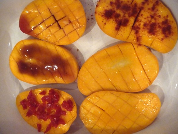 "Tom Goetting created ""Mangoes - Six Ways"" by baking halved and scored mangoes with a variety of toppings including piquant peppers, hoison sauce, port, sweet paprika and black bean sauce."