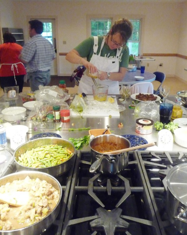 Georgie Kendall of Perry creates a traditional Ceasar dressing at Friday's improvisational cooking class at the Labor of Love Nutritional Center in Eastport.