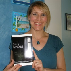 Courtney Harvey with the mock-up of the cover for her first novel.