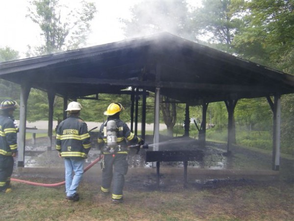 Jefferson firefighters finish extinguishing the June 2009 fire at the Damariscotta Lake State Park group shelter. The fire, set by vandals, destroyed the facility.