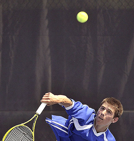 Eric Hall of Lewiston serves against Phillip Schoenberger of Hampden on Wednesday at Colby College in Waterville. Schoenberger won the match, but Lewiston won the other four to take the Eastern Maine Class A championship.