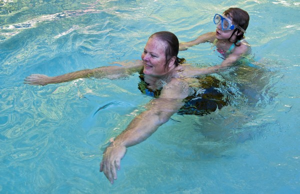 "Cheryll Moore swims with Mya in the family pool. ""I enjoy my granddaughter immensely,"" Moore said."