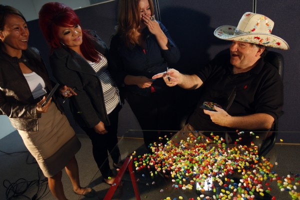 "David Klein, 64, inventor of the Jelly Belly jelly bean, signs DVD copies of the documentary, ""The Candyman: The David Klein Story,"" for Garvey Nut & Candy employees Wendy Jimenez (from left), Regina Barba and Amanda Sutton in Pico Rivera, California, June 16, 2011."