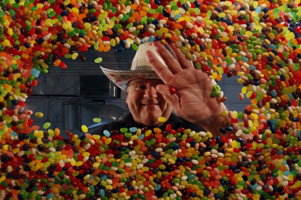 David Klein, 64, inventor of the Jelly Belly jelly bean, finds an opening in a sea of jelly beans at the Garvey Nut & Candy headquarters in Pico Rivera, California, June 16, 2011.