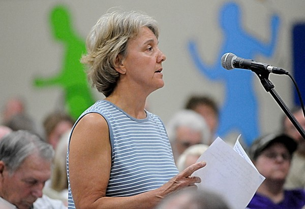 T.C. Conant, who owns a camp in Lakeville, ME with her husband Gary Conant , voices her opposition to the proposed Bowers wind project  during the Land Use Regulatory Commission's  public hearing Monday evening, June 27, 2011 at Ella P. Burr School in Lincoln.