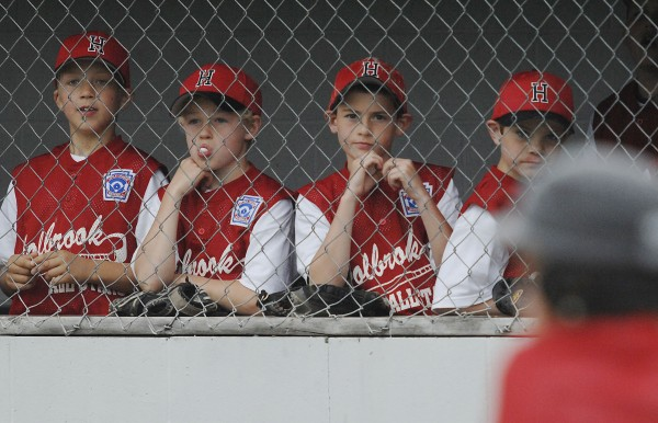 The Holbrook All-Star bench watches the pitcher-batter duel in the 7th inning of  their game against the Orrington All-Stars at Taylor Field in Bangor on Saturday, June 25, 2011.