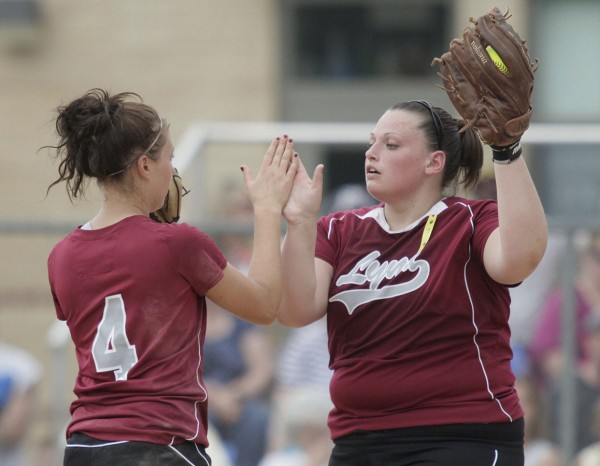 Mattanawcook Academy pitcher Tayla Trask (right) gets some encouragement from Brooke Kimball in the fourth inning against Bucksport during an Eastern Maine Class B quarterfinal Thursday in Bucksport. Bucksport defeated Mattanawcook 7-2.