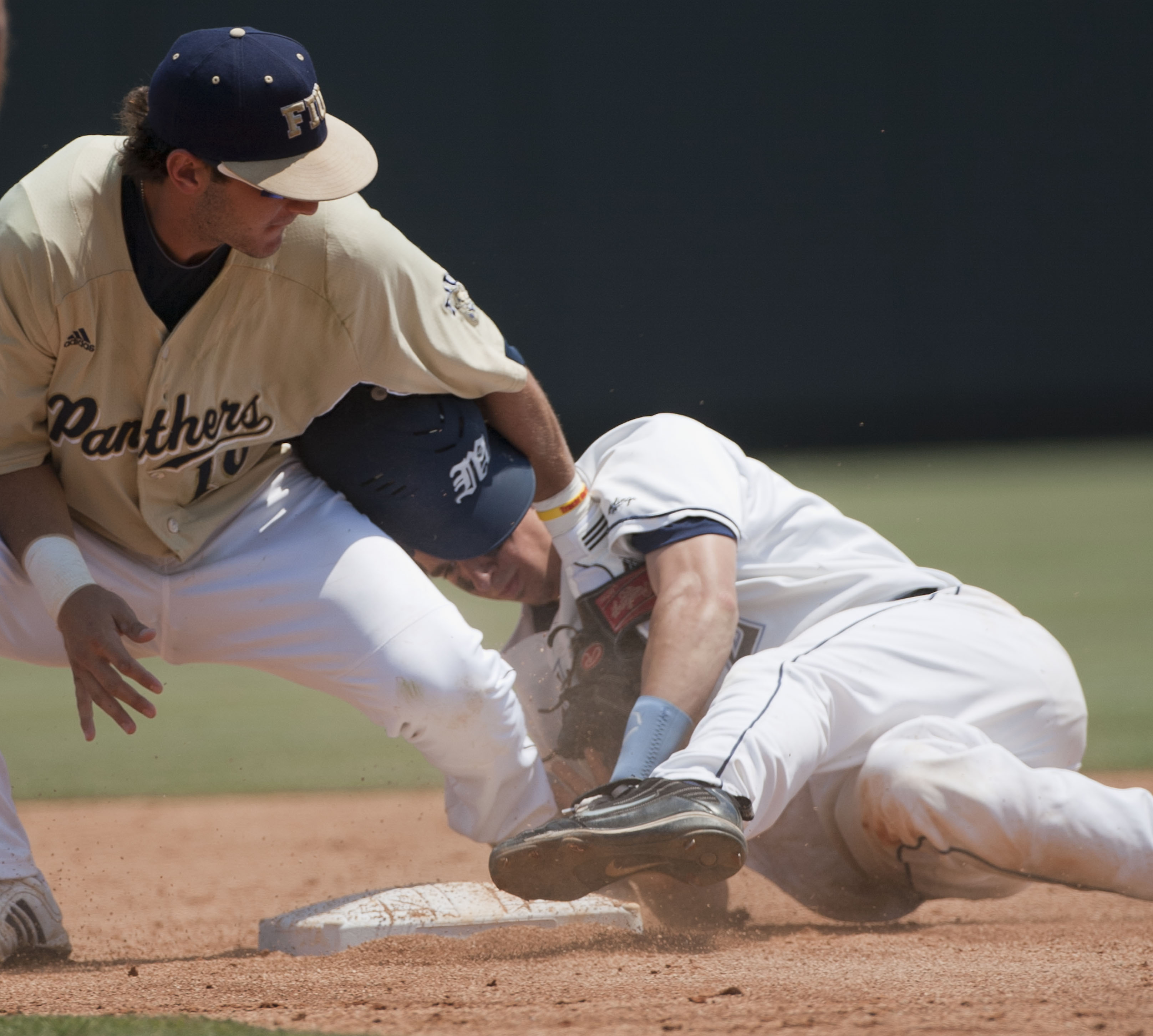 Maine's Michael Fransoso (2) steals second base, beating the tag by Florida International University's Garrett Wittels (10) in the fifth inning on Saturday June 4, 2011 at Boshamer Stadium in Chapel Hill, N.C.