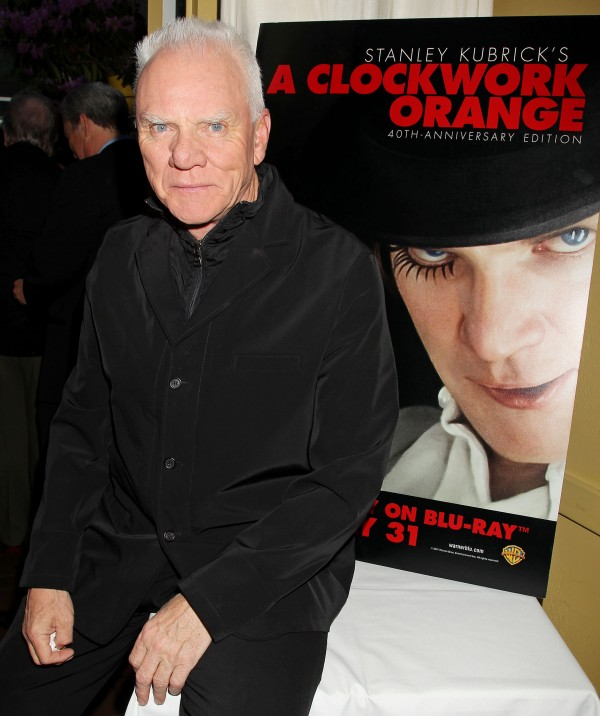 """A Clockwork Orange"" star Malcolm McDowell poses next to a poster bearing his circa 1971 likeness, at a party prior to a special screening of ""A Clockwork Orange - 40th Anniversary Edition,"" Wednesday, May 25, 2011 in New York."