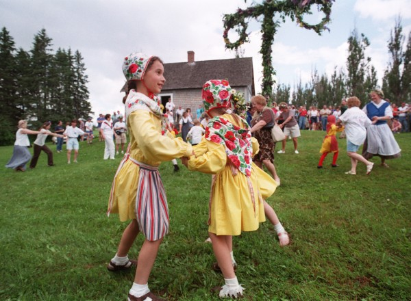 (4) Midsommar celebrants in Swedish costumes dance around the May pole during 1998's event in New Sweden. The annual festival will be held June 17-19. For a full schedule visit www.maineswedishcolony.info.