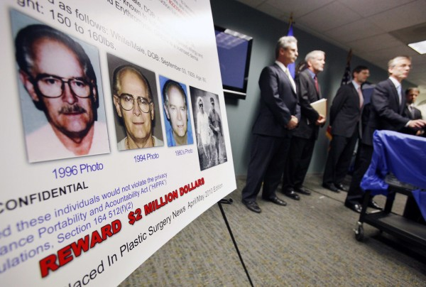 "FBI special agent Richard Deslauriers (right) speaks during a news conference next to a poster featuring fugitives James ""Whitey"" Bulger and Catherine Greig at the FBI field office in Boston on Monday, June 20, 2011. FBI agents on the trail of Bulger turned to TV ads aimed at women to try to bring the fugitive Boston mob boss to justice after 16 years on the run. Bulger and Greig were arrested Wednesday evening in Santa Monica, Calif."