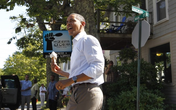 President Barack Obama holds a coconut ice cream cone after a visit to Mount Desert Island Ice Cream in Bar Harbor.
