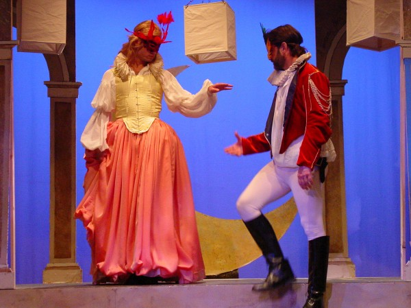 "Beatrice and Benedick (Craig Baldwin and Tommy Piper) engage in a dance in Opera House Arts' production of ""Much Ado About Nothing."""