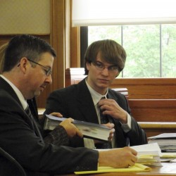 Thayne Ormsby, far right, talks to his attorneys, James Dunleavy, far left, and Sarah LeClaire, partially obscured, during a hearing in Aroostook County Superior Court in Houlton on Thursday, June 30, 2011. Ormsby has pleaded not guilty to three counts of murder for the deaths last June 22 of Jeffrey Ryan, 55, Jesse Ryan, 10, and Jason Dehahn, 30, all of Amity. He is trying to get statements he made to police after the murders thrown out, and attorneys made arguments in the case on Thursday. Ormsby reportedly confessed to the killings to State Police Detective Dale Keegan.