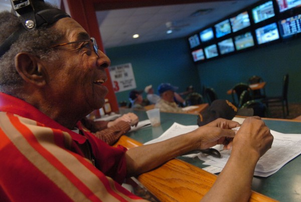 Nehemiah Caver of Bangor watches the horse races at the Bangor Raceway simulcast facility, located in the grandstand at Bass Park, on Monday, June 6, 2011. The simulcast lounge will soon be relocated to Hollywood Slots' Main Street location, which houses slot machines, a hotel, and dining and entertainment venues.