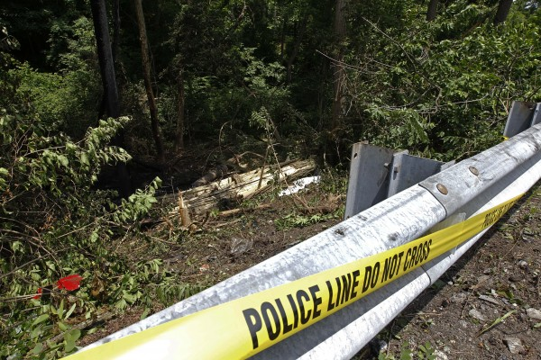 Police tape marks the scene of an auto accident Monday, June 20, 2011, in West Chester, Pa. West Goshen Township police say Jackass cast member Ryan Dunn and a passenger died after his car left the roadway and burst into flames.