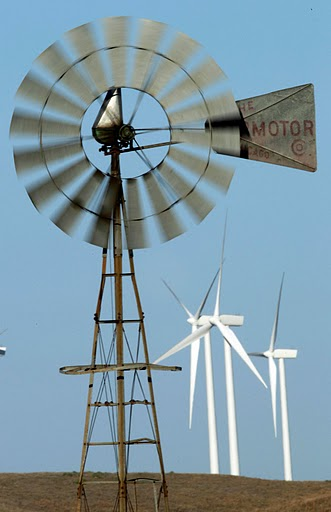 In this Oct. 20, 2010 photo, a working wind mill turns with a background of wind turbines from the Smoky Hills Wind Farm near Ellsworth, Kan.