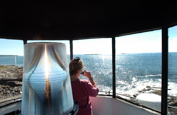 (13) Kathy Doucette of East Bridgewater, Mass. takes in the view from inside Marshall Point Lighthouse in St. George in 2010 as part of the second annual Maine Open Lighthouse Day. For two days in June, Mainers and visitors have the opportunity to go inside seven lighthouses in the midcoast.For information, visit www.rocklandlighthouse.com/challenge.html.