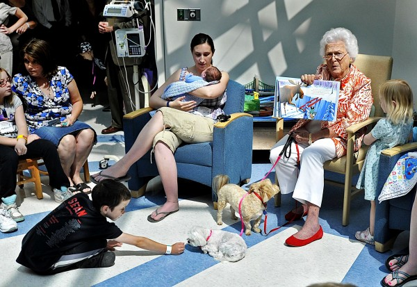 Former first lady Barbara Bush celebrates her 86th birthday by reading to young patients at The Barbara Bush Children's Hospital at the Maine Medical Center in Portland, Maine on Wednesday, June 8.