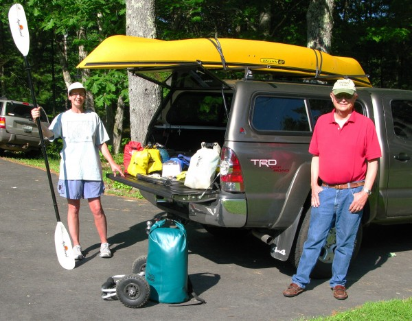 Seasoned paddler Laurie Chandler with her father, George Apgar, displaying the kayak and supplies Laurie will use on her solo 347-mile children's cancer research fundraising trek across northern Maine this summer. Photo: Bill Bausch