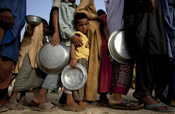 In this Aug. 28, 2010 file photo, a Pakistani flood survivor child waits for his turn to get food at a camp in Sukkur, in southern Pakistan. More than 42 million people were forced to flee their homes because of natural disasters around the world in 2010, more than double the number during the previous year, experts said Monday, June 6, 2011.