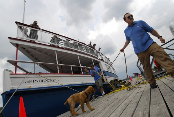 Gabriel Everett (right) of Levant, a deck hand with the 29th century replica steam ferry Patience, helps moor the vessel after it returned to Bangor after a one-hour cruise on the Penobscot River in June 2007.