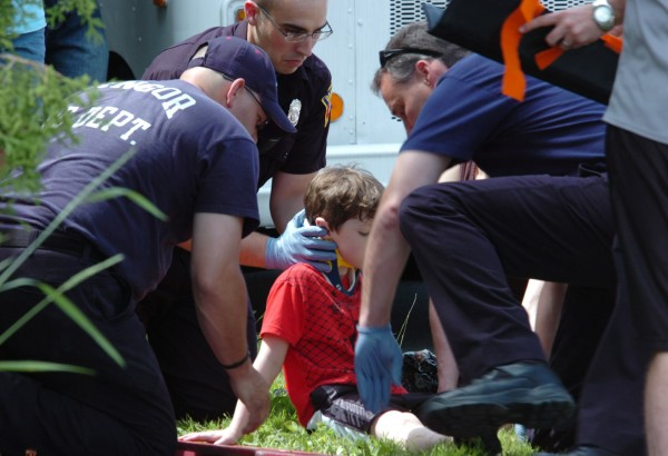 Bangor rescue personnel tend to a boy who was struck  by a vehicle near the intersection of Buck and Bond streets in Bangor Wednesday, June 22, 2011.  Officer Steve Jordan, investigating the incident for Bangor Police Dept.,  said that the boy had dashed across the street by himself.