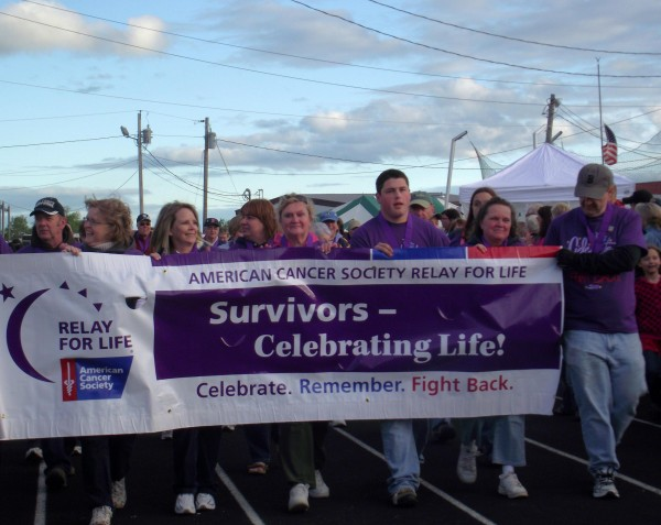 Cancer survivors walk the first lap of the track at the Aroostook County Relay For Life to benefit the American Cancer Society on Friday evening, June 4, in Caribou. More than 800 people registered to take part in the event, spending all night walking the track and field complex at Caribou High School to raise money and fight for a cure.