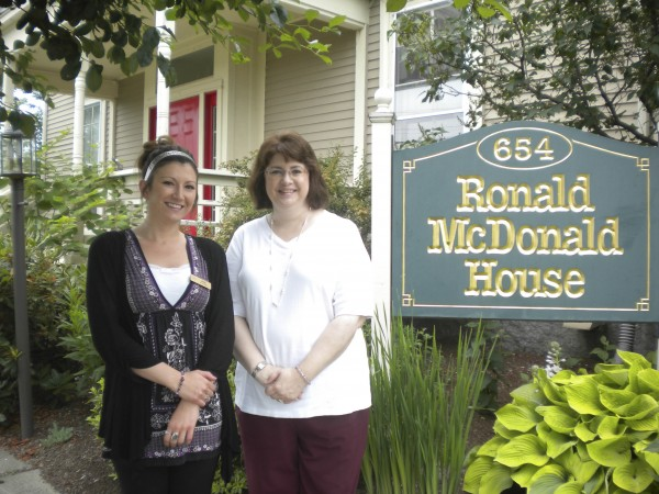 On behalf of residents and staff, Dirigo Pines activity assistant Jade Botting (left) presented household items to Ronald McDonald House of Bangor executive director Darlene MacLeod (right).