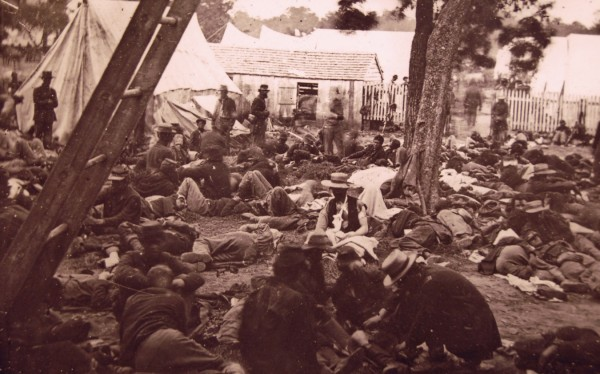 Union soldiers wounded during the July 29, 1862, Battle of Savage's Station in Virginia lie outside a field hospital near the battlefield. Sarah Sampson was volunteering as a nurse at such a field hospital — perhaps even this one — when a Confederate attack overran the facility and forced her to flee to avoid capture.