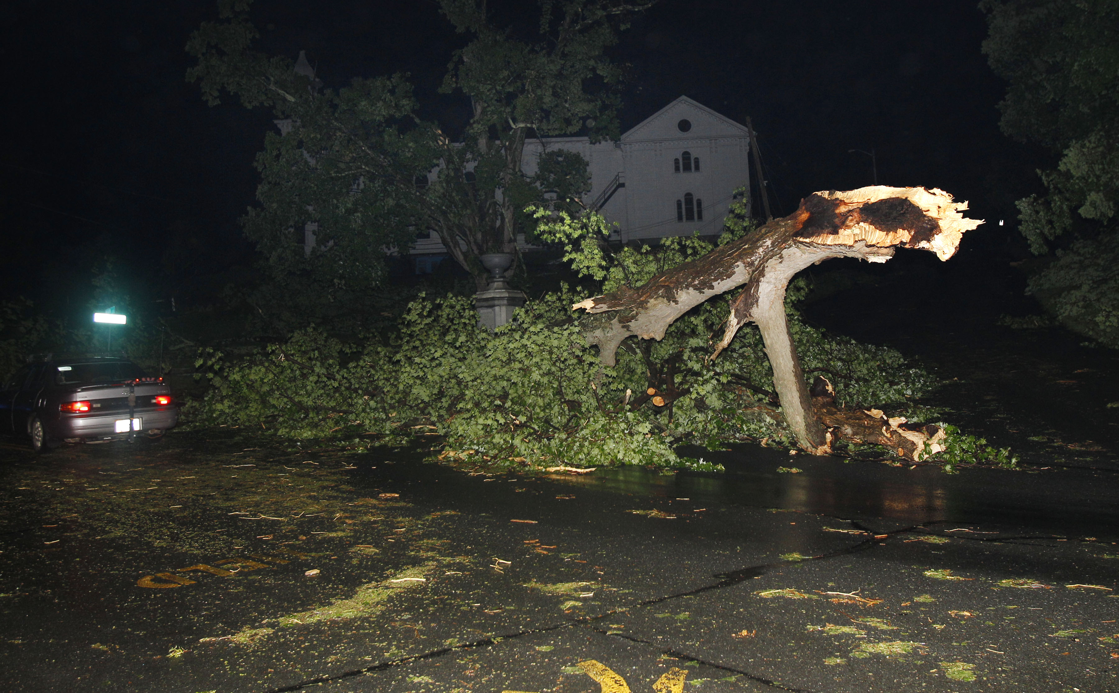 Large trees and debris litter a street after a tornado swept through Monson, Mass. Wednesday, June 1, 2011.