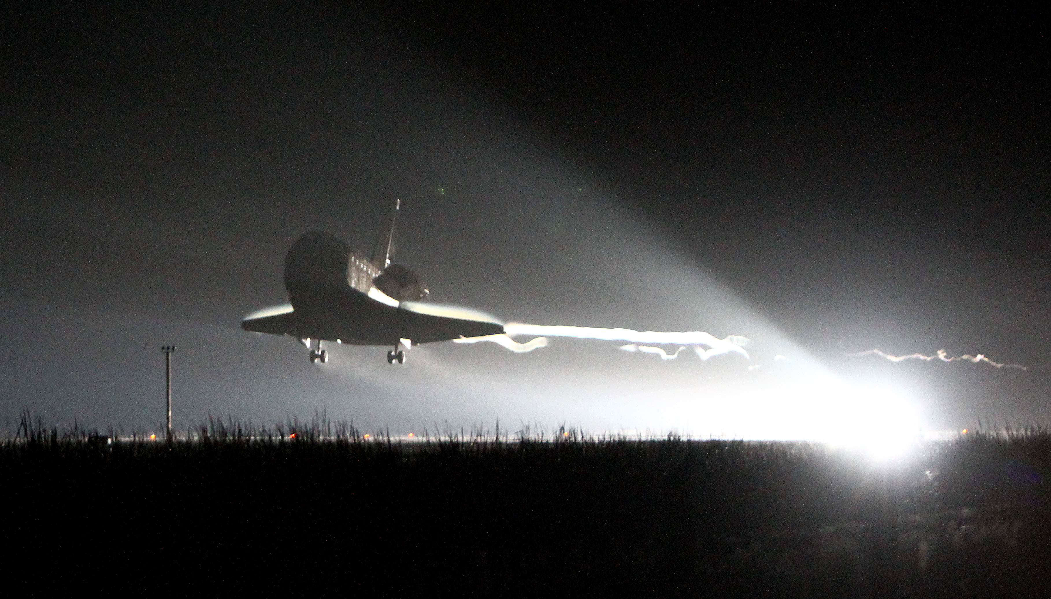 The space shuttle Endeavour prepares to land after completing her final flight at the Kennedy Space Center in Cape Canaveral, Fla., Wednesday, June 1, 2011. Endeavour , and her crew of six astronauts, wrapped up a 16 day mission to the international space station.