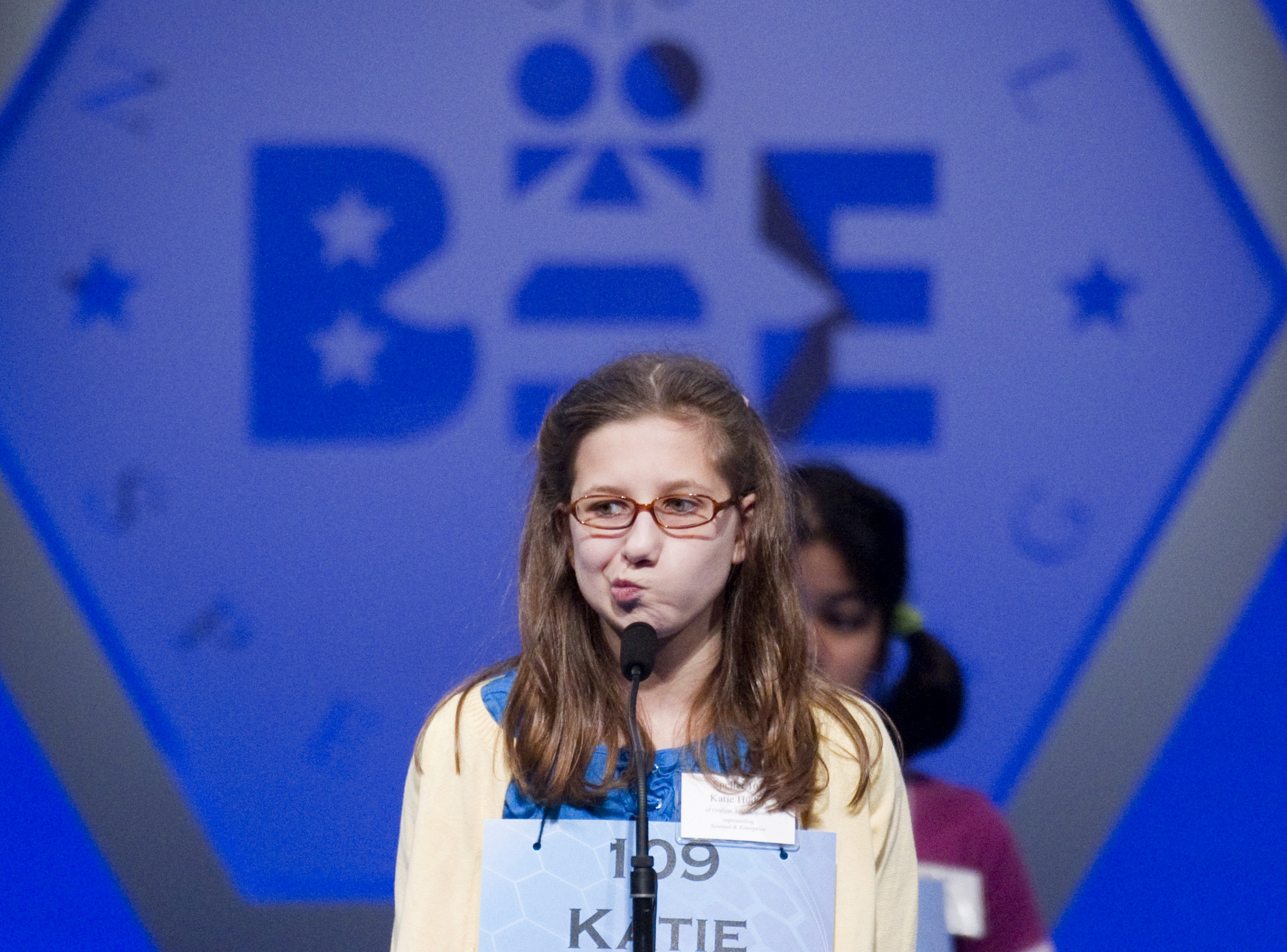 Katie A. Hudek, 12, from Fitchburg, Mass. searches for the correct spelling for &quottokamak&quot during round three of the National Spelling Bee, Wednesday, June 1, 2011, in National Harbor, Md.  She answered the question correctly.