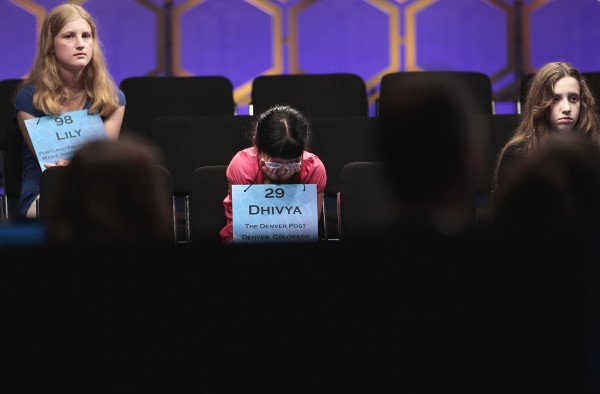 From left to right, Lily Jordan, 14, from Portland, Maine, Dhivya Senthil Murugan, 10, from Denver, Colo., and Veronica I. Penny, 13, from Ottawa, Canada sit through the end of the semifinals of the 2011 Scripps National Spelling Bee at the Gaylord National Resort and Convention Center in Oxon Hill, Md., Thursday, June 2, 2011.
