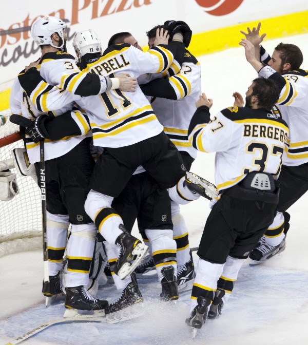 Boston Bruins celebrate after defeating the Vancouver Canucks 4-0 in Game 7 of the NHL hockey Stanley Cup Finals on Wednesday, June 15, 2011, in Vancouver, British Columbia.
