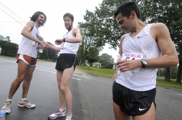 Adam Goode (center) of Bangor checked his watch as friend and fellow UMaine alumnus Josh Trevino of Texas congratulated him as they hung out with winner Louie Luchini (right) of Ellsworth in the finish area of the 36th Tour Du Lac 10 miler in Bucksport on Saturday morning, June 25, 2011. Luchini, who also won last year, ran the course in 50:20, breaking the Gerry Clapper's 25-year-old record by 26 seconds. Trevino ran 51:36 for second place and Goode ran 53:21 for third place.