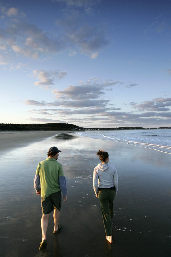 (25) Ken Zion (left) and Flyn Costello, stroll the edge of the surf during a late afternoon visit to Popham Beach State Park, in Phippsburg in 2007.